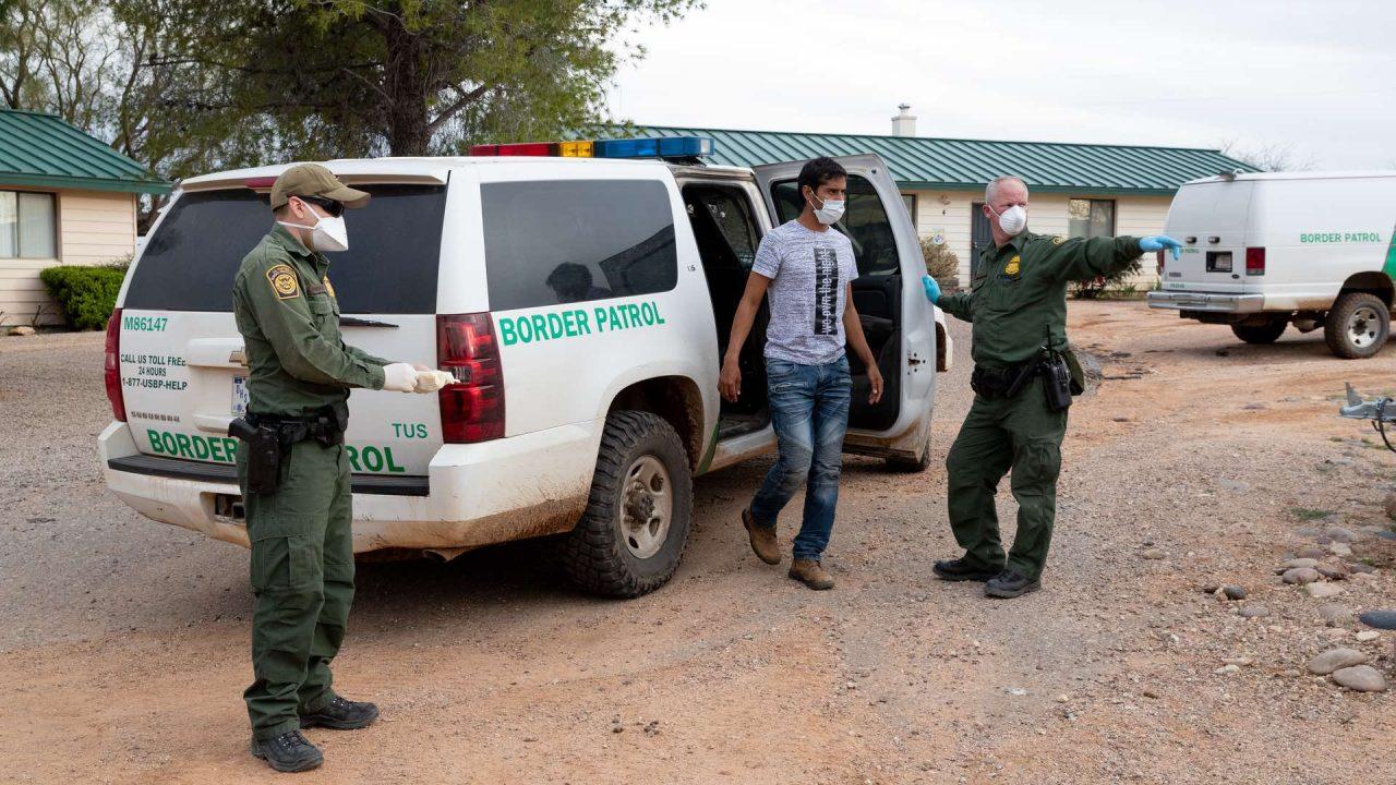 https://thetexan.news/wp-content/uploads/2020/07/Border-Patrol-with-Immigrant-1280x720.jpg