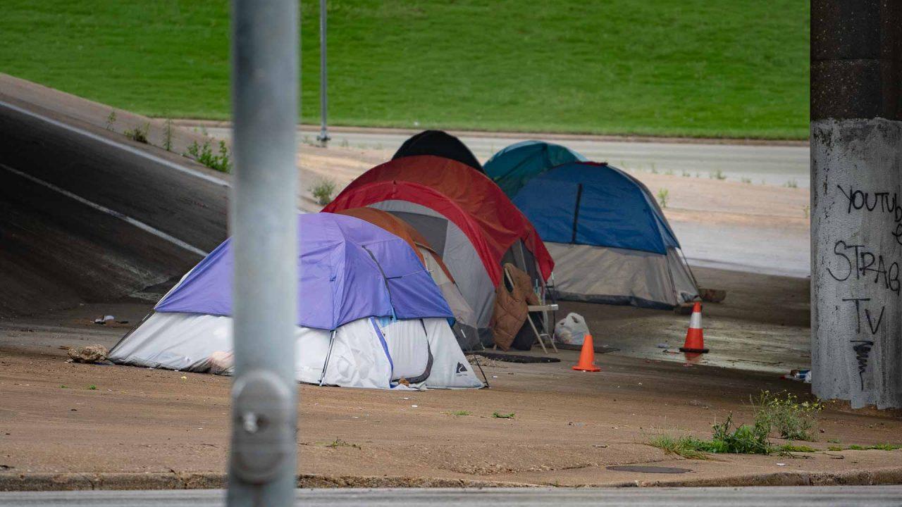 https://thetexan.news/wp-content/uploads/2021/05/Homeless-Camping-Tents-in-Austin-Under-Overpass-1280x720.jpg