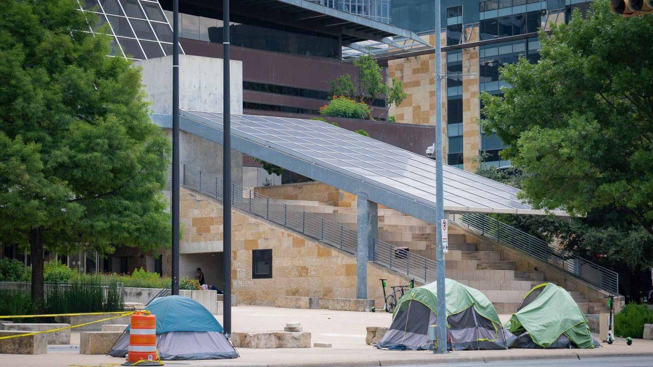 https://thetexan.news/wp-content/uploads/2021/06/Homeless-Camping-Outside-Austin-City-Hall-2-1280x720.jpg