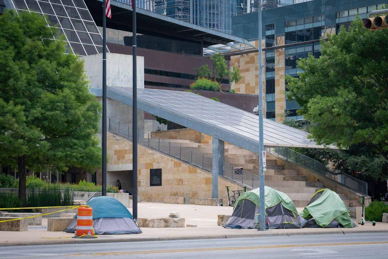 https://thetexan.news/wp-content/uploads/2021/06/Homeless-Camping-Outside-Austin-City-Hall-2-1280x853.jpg