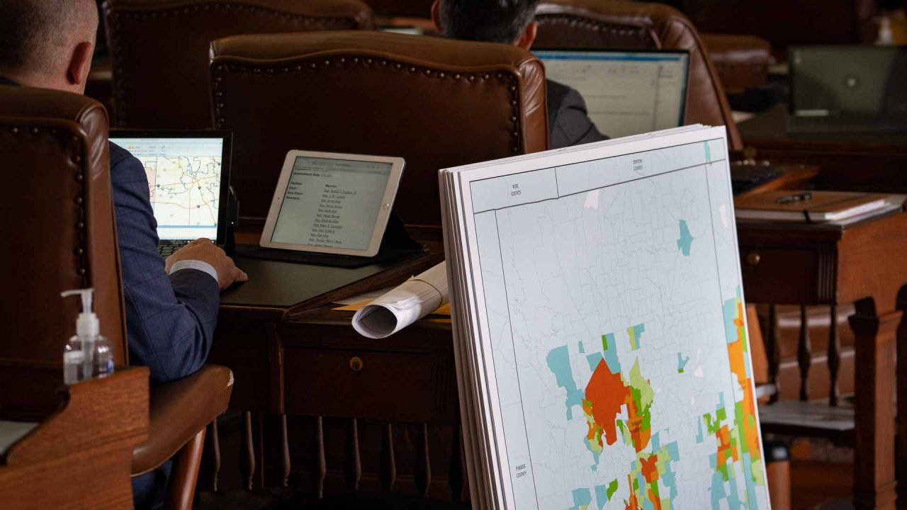 https://thetexan.news/wp-content/uploads/2021/10/Texas-House-Redistricting-Tarrant-County-Map-and-Chris-Turner-Working-at-Desk-DF-1280x720.jpg